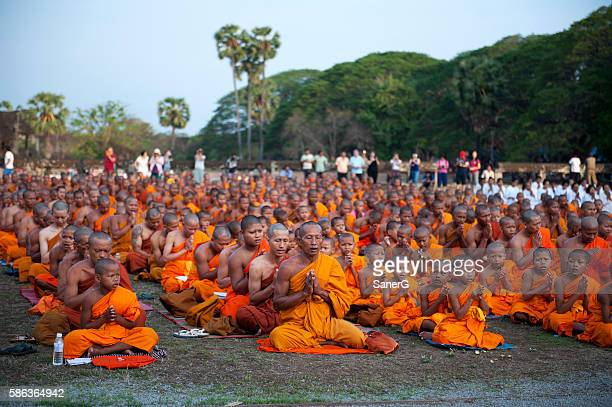 Buddhist monks praying in Angkor Wat