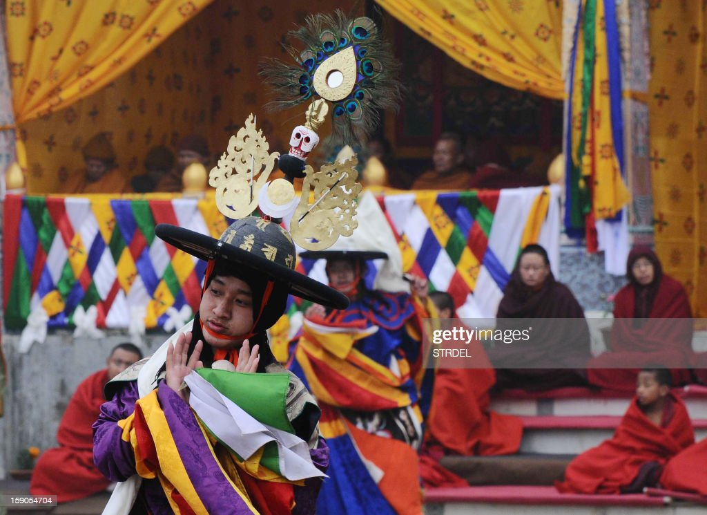 Buddhist monks preform a traditional dance at a Bhutan monastery in Bodhgaya on January 7, 2012. Bodhgaya is famous for being the place where Gautama Buddha is said to have obtained enlightenment. AFP PHOTO/ STR