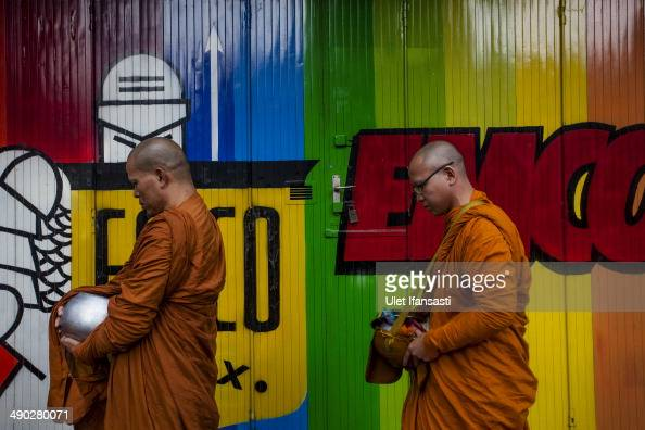 Buddhist monks prepare at a temple before a walk around the streets to receive religious alms from Buddhist followers during Pindapata procession on...