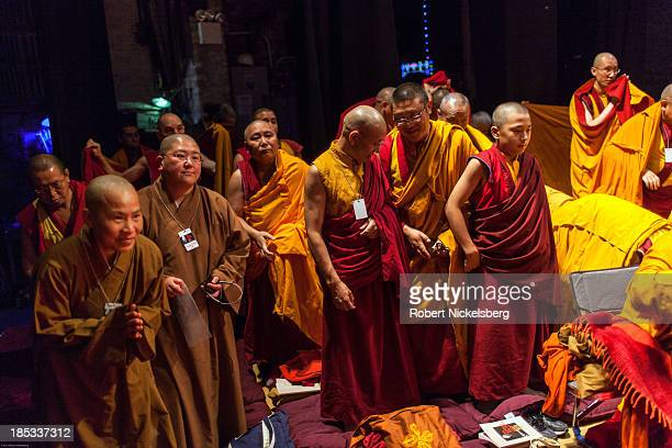 Buddhist monks prepare to leave after the Dalai Lama finished speaking to an audience at the Beacon Theater October 18 2013 in New York City The...