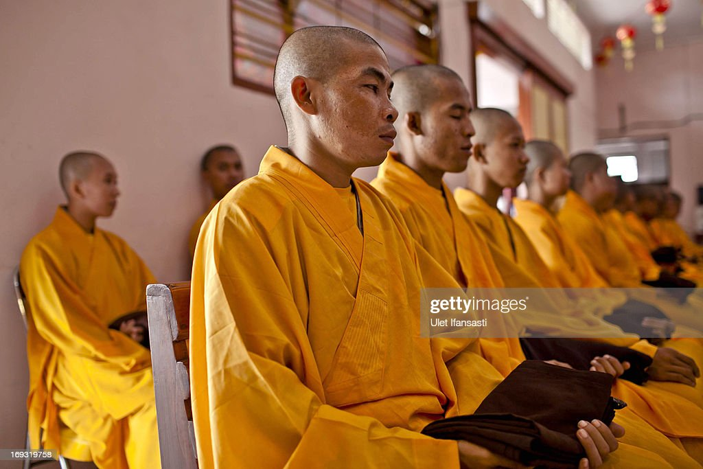 Buddhist monks prepares at the temple after walking around the streets to receive religious alms from Buddhist during Pindapata procession on May 23, 2013 in Magelang, Central Java, Indonesia. As many as 100 monks took to the streets of Magelang city in a procession known as Pindapata, ahead of Vesak day which celebrates the birth of the Lord Buddha.
