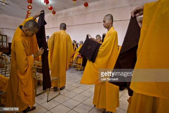 Buddhist monks prepares at the temple after walking around the streets to receive religious alms from Buddhist during Pindapata procession on May 23...