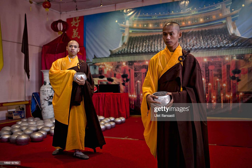 Buddhist monks prepares at the temple before walk around the streets to receive religious alms from Buddhist during Pindapata procession on May 23, 2013 in Magelang, Central Java, Indonesia. As many as 100 monks took to the streets of Magelang city in a procession known as Pindapata, ahead of Vesak day which celebrates the birth of the Lord Buddha.