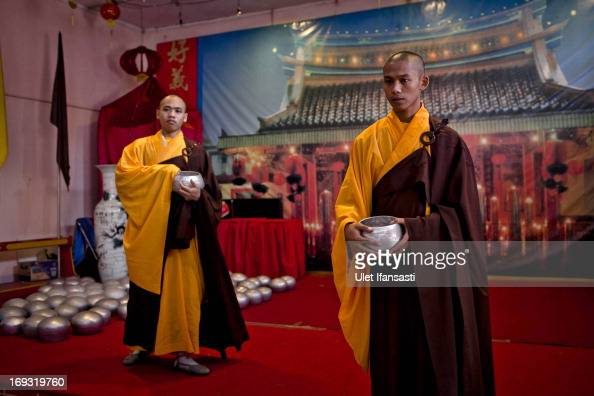 Buddhist monks prepares at the temple before walk around the streets to receive religious alms from Buddhist during Pindapata procession on May 23...