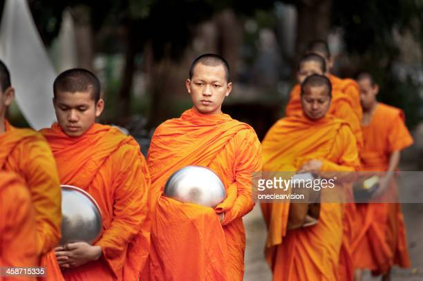 Buddhist Monks Receive Offerings
