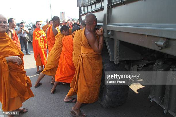 Buddhist monks scuffled with troops during protest against to state interference in religious affairs at Office of National Buddhism in Nakhon Pathom