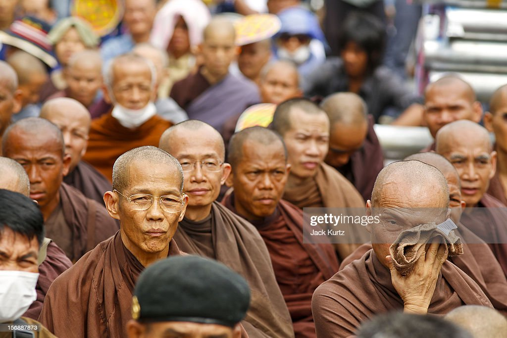 Buddhist monks sit on the ground in front of riot police during a large anti government protest on November 24, 2012 in Bangkok, Thailand. The Siam Pitak group, which sponsored the protest, cited alleged government corruption and anti-monarchist elements within the ruling party as grounds for the protest. Police used tear gas and baton charges againt protesters.