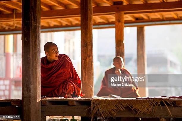 Buddhist monks studying below monastery