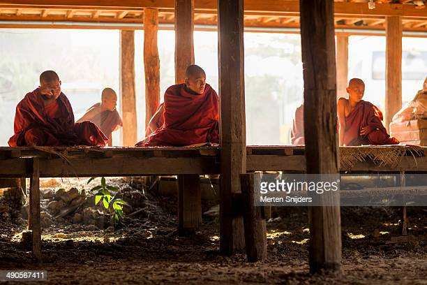 Buddhist monks studying below monastery