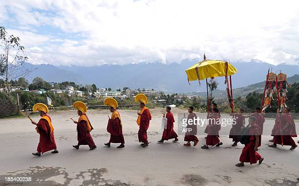 Buddhist monks take out a religious procession on the occasion of the Tawang festival 2013 in Tawang near the Chinese border in Tawang district of...