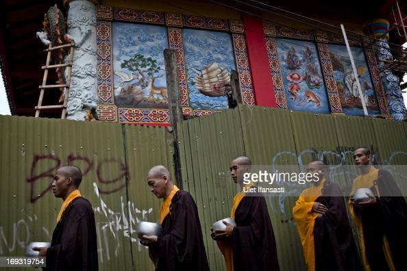Buddhist monks walk around the streets to receive religious alms from Buddhist members during Pindapata procession on May 23 2013 in Magelang Central...