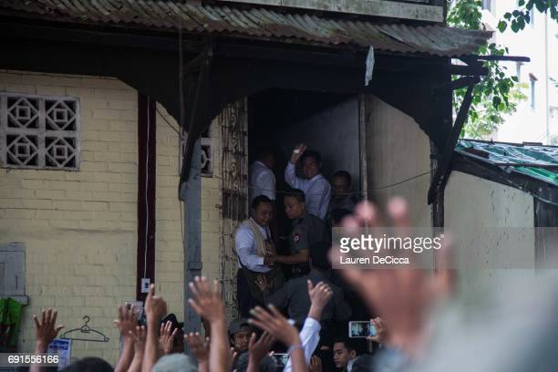 Buddhist Nationalist Leader Ma Aung shouts to the crowd of nationalist Buddhist followers as he enters the Mingalartaungnyunt courthouse for trial on...