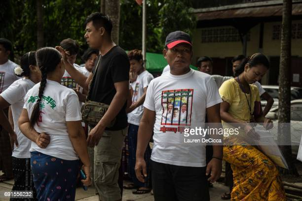 Buddhist nationalists protest the trial of their fellow nationalists outside of the Mingalartaungnyunt courthouse on June 2 2017 in Yangon Burma...