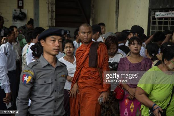 Buddhist nationalists wait for the results of their fellow nationalists trial outside of the Mingalartaungnyunt courthouse on June 2 2017 in Yangon...