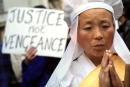 Buddhist nun chants October 2 2001 during a vigil for peace opposite the British Prime Minister's residence in Downing Street in London