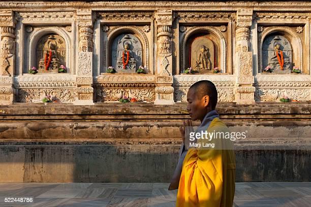 BODHGAYA BIHAR INDIA BODHGAYA BIHAR INDIA A buddhist nun walking and praying around the Mahabodhi temple Bodhgaya Bihar India The Mahabodhi Temple is...