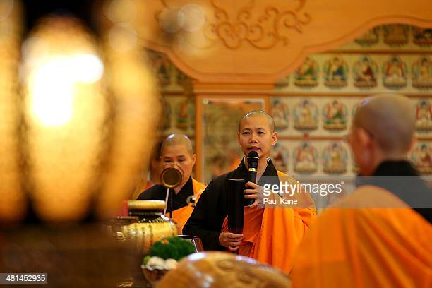 Buddhist nuns conduct a prayer and blessing service at the Fo Guang Shan Temple in Maylands on March 30 2014 in Perth Australia The Buddha's Light...