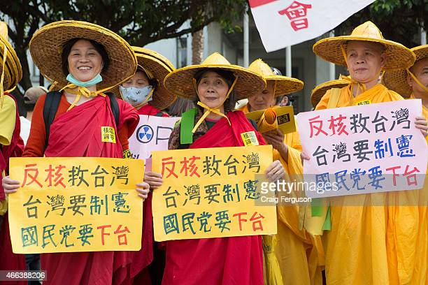 Buddhist nuns opposed to the use of nuclear energy in Taiwan hold signs during an antinuclear rally