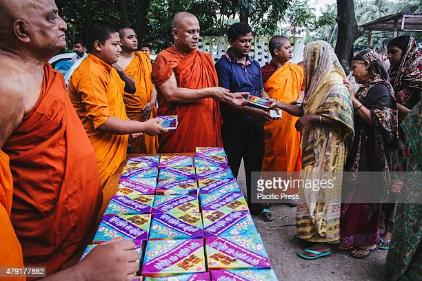 Buddhist Organization named 'Dhormorajik Buddho Mohabihar' is giving quality food as 'Iftar' for free to poor fasting Muslims who can't afford good...