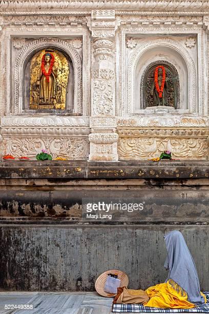 BODHGAYA BIHAR INDIA BODHGAYA BIHAR INDIA Buddhist pilgrim meditating in Mahabodhi Mahavihara temple Bodh Gaya Bihar India The Mahabodhi Temple is a...