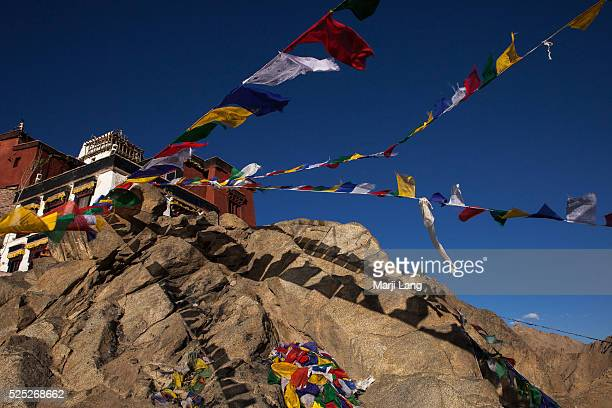 Buddhist prayer flags in the wind at Namgyal Tsemo gompa situated on a mountain top behind the Leh palace the monastery offers panoramic views of the...