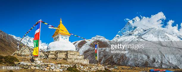 Buddhist prayer flags stupa shrine high in Himalayan mountains Nepal