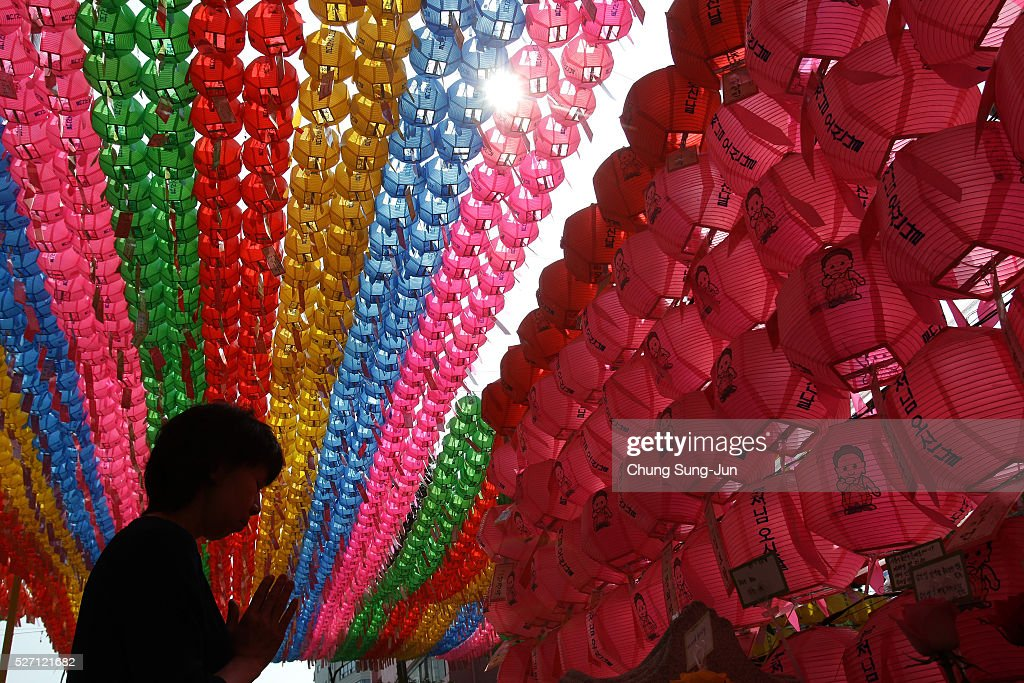 A buddhist prays under colorful lanterns during the 'Children Becoming Buddhist Monks' ceremony forthcoming buddha's birthday at a Chogye temple on May 2, 2016 in Seoul, South Korea. Children have their hair shaved off during the 'Children Becoming Buddhist Monks' ceremony ahead of buddha's birthday at a Chogye temple. The children will stay at the temple to learn about Buddhism for 14 days. Buddha was born approximately 2,560 years ago, and although the exact date is unknown, Buddha's official birthday is celebrated on the full moon in May in South Korea, which is on May 14 this year.