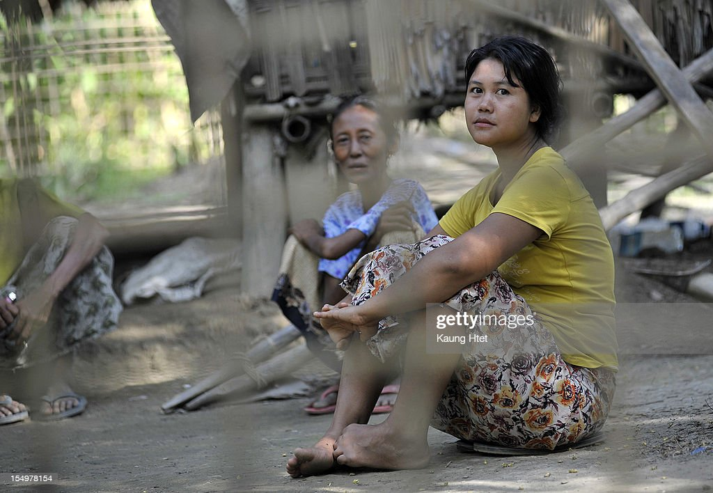 Buddhist Rakhine Ladies sit in the front of their house in Rakhine quarter of Pa Rein village, Myauk Oo township on October 29, 2012 in Rakhine state, Myanmar. Over twenty thousand people have been left displaced following violent clashes which has so far claimed a reported 80 lives. Clashes between Rakhine people, who make up the majority of the state's population, and Muslims from the state of Rohingya began in June.