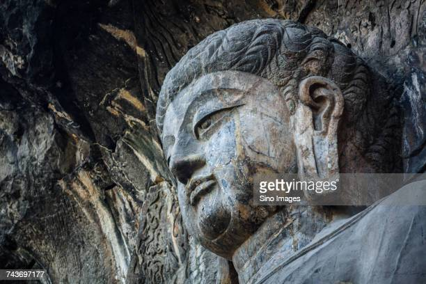 Buddhist sculpture in main grotto of Longmen Caves in Luoyang, Henan, China
