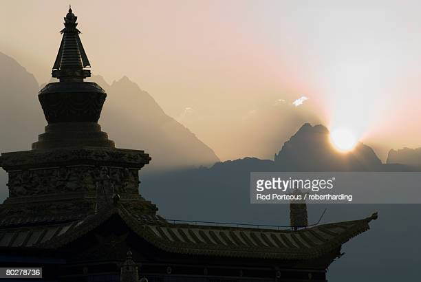 Buddhist temple at dawn with mountains beyond, Snow mountain, Tagong Grasslands, Sichuan, China, Asia