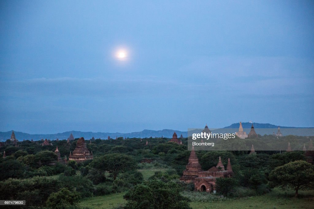 Buddhist temples and pagodas stand at sunrise in Bagan, Myanmar, on Saturday, June 10, 2017. When the country opened to the outside world in 2011 after decades of military rule, the former British colony held promise as one of the worlds hottest tourist destinations, a last frontier for adventure travel.But it hasn't worked out that way. A construction glut has flooded Myanmar with unused hotel rooms, and poorly regulated building has damaged national treasures like the archaeological site of Bagan. Photographer: Taylor Weidman/Bloomberg via Getty Images