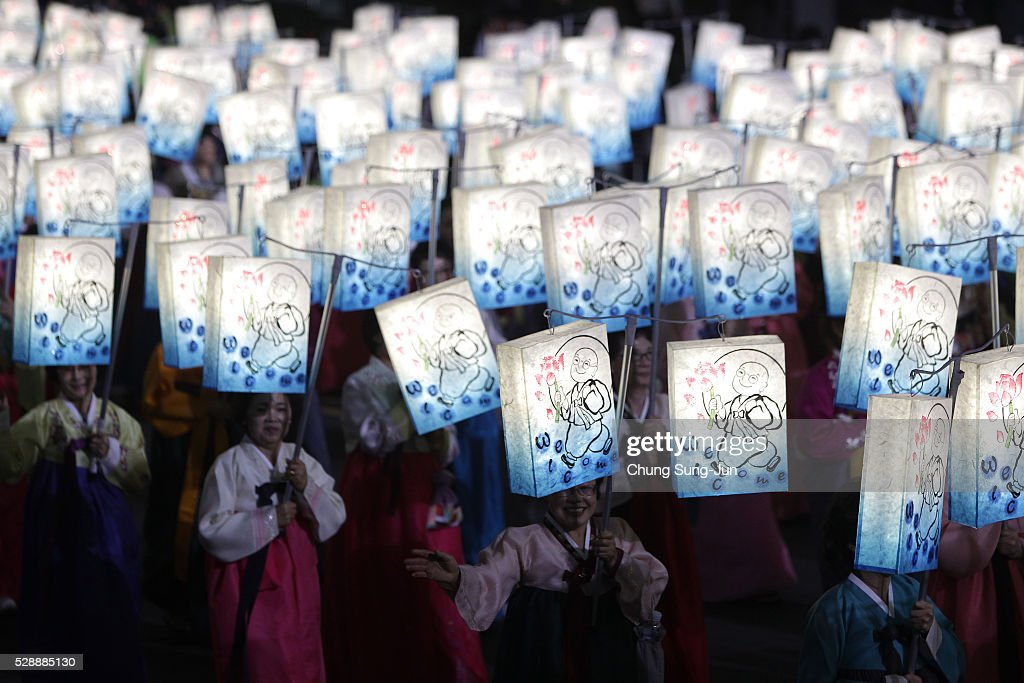 Buddhists carry colorful lanterns as they celebrate the forthcoming birthday of Buddha on May 7 2016 in Seoul South Korea Buddha was born...