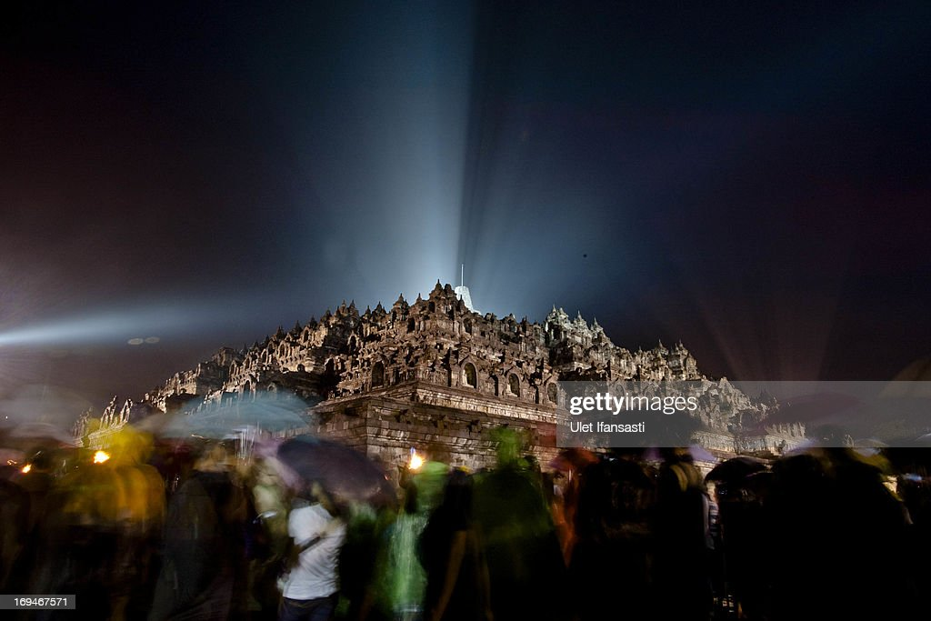 Buddhists celebrate Vesak Day at the Borobudur temple despite heavy rains on May 25, 2013 in Magelang, Central Java, Indonesia. Vesak is observed during the full moon in May or June with the ceremony centering around three Buddhist temples; pilgrims walk from Mendut to Pawon, ending at Borobudur. The holy day celebrates the birth, the enlightenment to nirvana, and the passing of Gautama Buddha's, the founder of Buddhism.