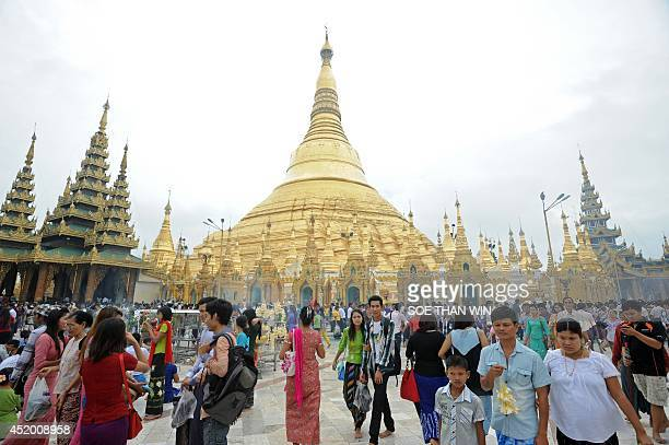 Buddhists devotee visit Myanmar's landmark Shwedagon pagoda on the first day of Buddhist lent in Yangon on July 11 2014 Buddhist Lent is a period of...