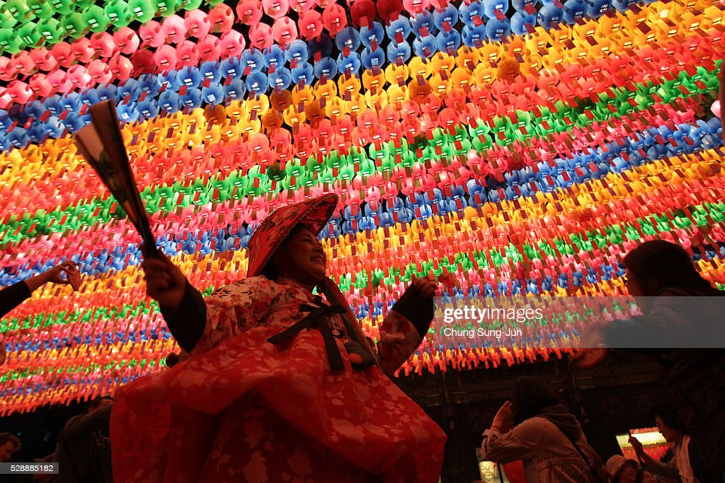 Buddhists gather under colorful lanterns as they celebrate the forthcoming birthday of Buddha at Jogye temple on May 7 2016 in Seoul South Korea...