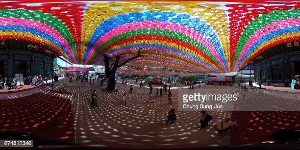 Buddhists gather under colorful lanterns as they celebrate the forthcoming birthday of Buddha at Jogye temple on April 29 2017 in Seoul South Korea...