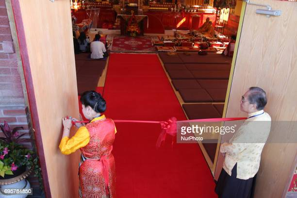 Buddhists hang a large ribbon outside the main prayer hall in preparation for the arrival of His Holiness the 17th Gyalwang Karmapa Ogyen Trinley...
