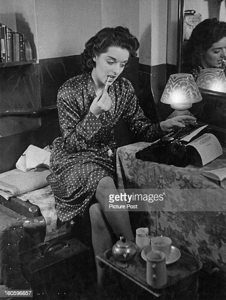 Budding author Lesley Osmond writing backstage during a break from dancing in 'Revedeville' at the Windmill Theatre The girls dance for 6 hours then...