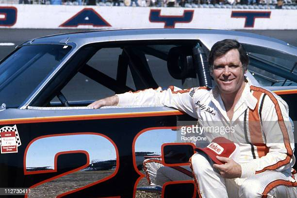 Buddy Baker with the Harry Ranierowned Oldsmobile before a NASCAR Cup race at Daytona International Speedway Baker won the pole position for both the...