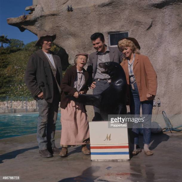 Buddy Ebsen Irene Ryan Max Baer Jr and Donna Douglas in character as 'Jed Clampett' 'Granny' 'Jethro Bodine' and 'Elly May Clampett' posed with a sea...