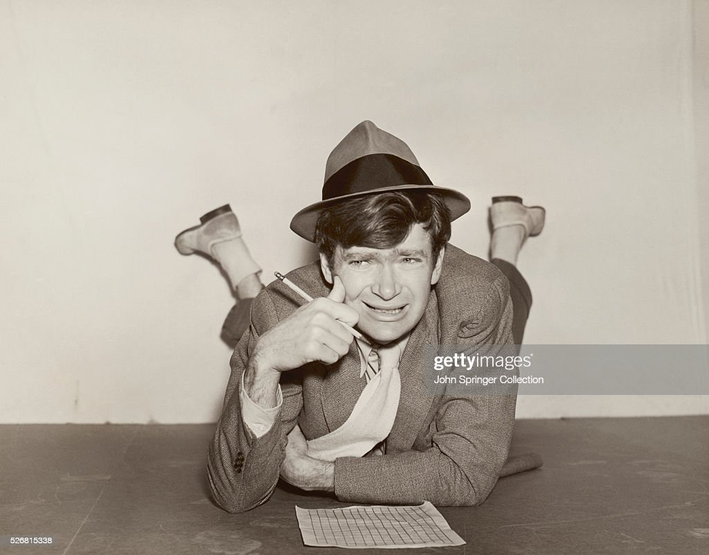 <a gi-track='captionPersonalityLinkClicked' href=/galleries/search?phrase=Buddy+Ebsen&family=editorial&specificpeople=894081 ng-click='$event.stopPropagation()'>Buddy Ebsen</a> looks stumped as he works on a crossword puzzle lying on the floor.