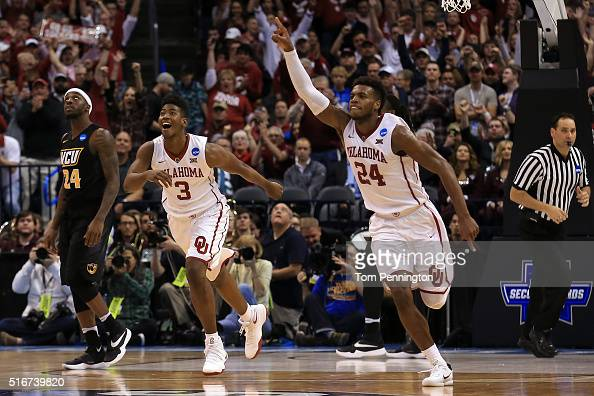 Buddy Hield and Christian James of the Oklahoma Sooners celebrate after defeating the Virginia Commonwealth Rams with a score of 81 to 85 during the...