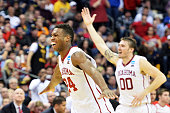 Buddy Hield and Ryan Spangler of the Oklahoma Sooners celebrate their 72 to 66 win over the Dayton Flyers during the third round of the 2015 NCAA...
