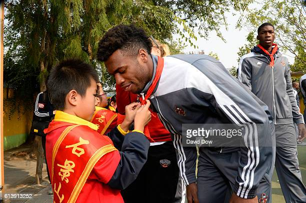 Buddy Hield of the New Orleans Pelicans gets a scarf during the NBA Cares Learn and Play Center Dedication part of the 2016 Global Games China at...