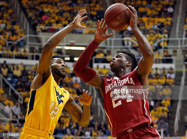 Buddy Hield of the Oklahoma Sooners and Tarik Phillip of the West Virginia Mountaineers battle for a rebound during the game at the WVU Coliseum on...