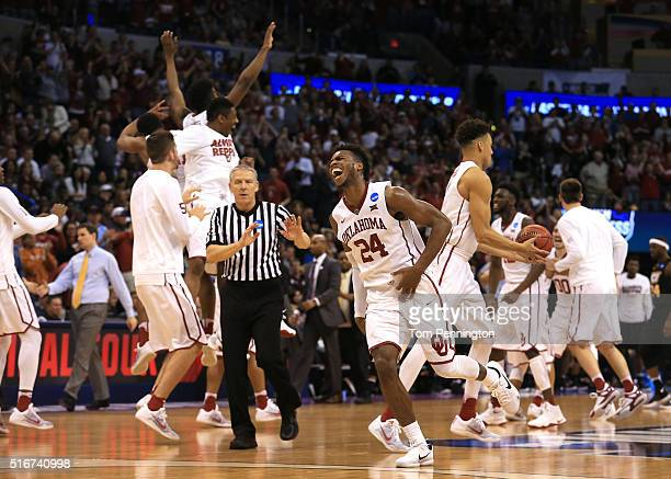 Buddy Hield of the Oklahoma Sooners celebrates with his teammates after defeating the Virginia Commonwealth Rams with a score of 81 to 85 during the...