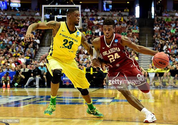 Buddy Hield of the Oklahoma Sooners drives on Elgin Cook of the Oregon Ducks in the second half in the NCAA Men's Basketball Tournament West Regional...