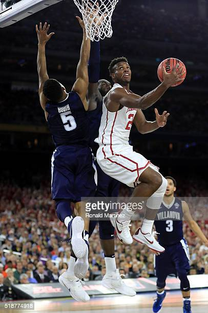 Buddy Hield of the Oklahoma Sooners drives to the basket against Phil Booth of the Villanova Wildcats in the first half during the NCAA Men's Final...