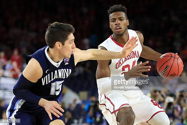Buddy Hield of the Oklahoma Sooners handles the ball against Ryan Arcidiacono of the Villanova Wildcats in the first half during the NCAA Men's Final...