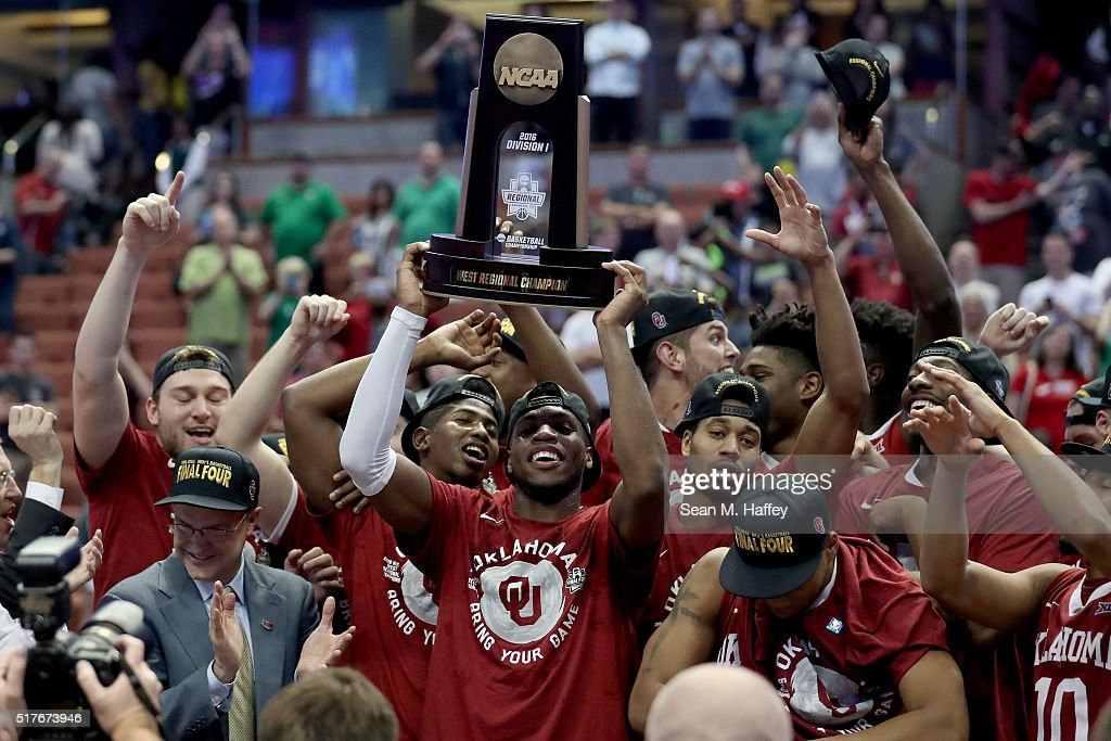 Buddy Hield of the Oklahoma Sooners holds up the West Regional trophy after the Sooners 8068 victory against the Oregon Ducks in the NCAA Men's...